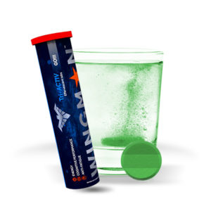 Wingman Go! effervescent drink tabs tube next to glass of refreshing water